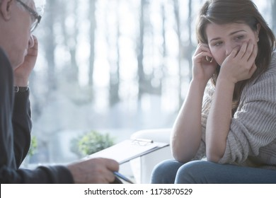 Sad depressed woman with nervous breakdown during therapy with psychiatrist