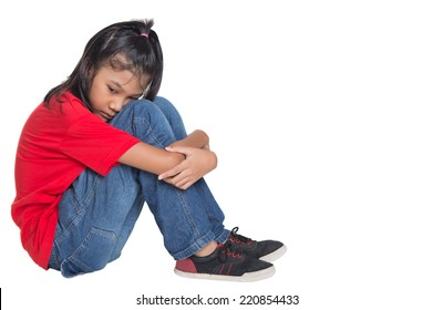 Sad and depressed young Asian girl over white background