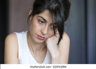 Sad or Depressed Young Beautiful Woman