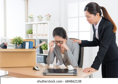 sad depression business woman getting layoff message crying in working office and pretty elegant company colleague girl consolation her.