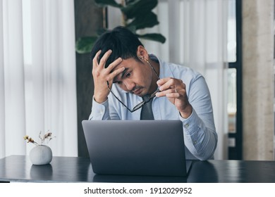 sad depression serious people from work,study stress concept.asian man feeling tired suffering using computer working work place.concept global economic,health problems