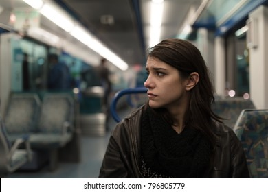 Sad depressive woman in train going home from work.Tired exhausted looking young lady getting away with train ride.Bored female person during commute time.Public transportation user