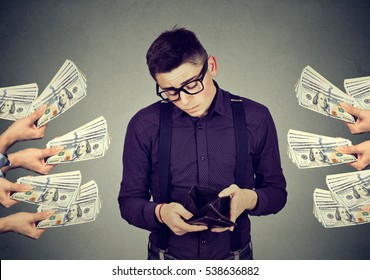 Sad desperate man with empty wallet being offered money dollar banknotes