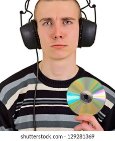 Sad disappointed teenager male music lover with big headphones and compact disk