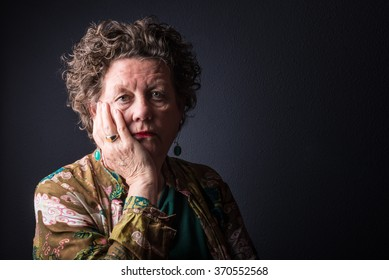 Sad elderly woman contemplating. Senior. Older woman.