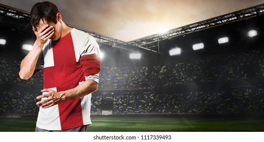 Sad England national team soccer or football player on stadium