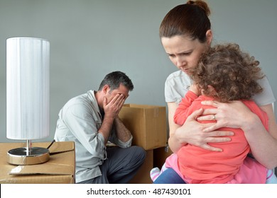 Sad evicted family worried relocating house.  Family financial problems concept. Real people. copy space