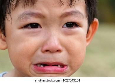 Sad expression Asian boy crying