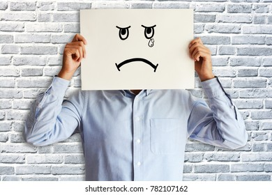 Sad face or disappointed employee, no satisfaction at job concept