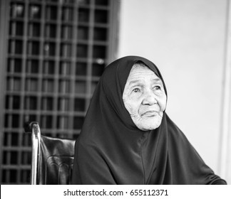 A sad face of an old lady from Malay ethnic