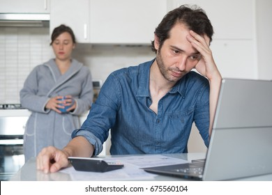 Sad family man trying to find a solution for taxes and debts