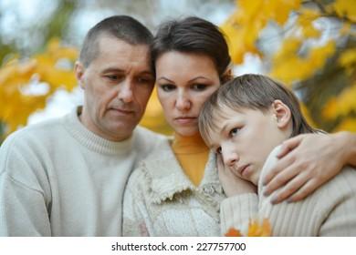 sad family of three on the nature