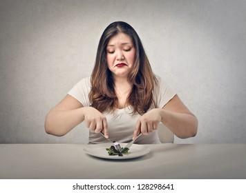 sad fat woman eating salad