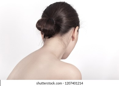 sad female topless back on white background