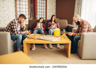Sad friends drinks beer at the boring home party