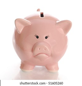 sad or frowning piggy bank money box with reflection on white background