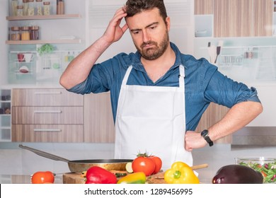Sad and frustrated man with problem in the kitchen