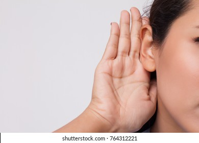 sad frustrated unhappy woman listening ear to bad news or having hearing impair, hard of hearing