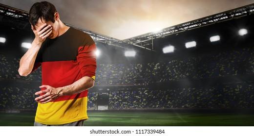 Sad Germany national team soccer or football player on stadium
