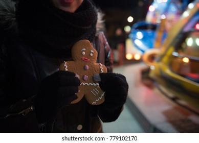 sad gingerbread man with mark of bit on head