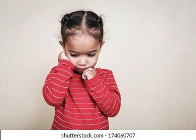 Sad girl with a bandaged finger