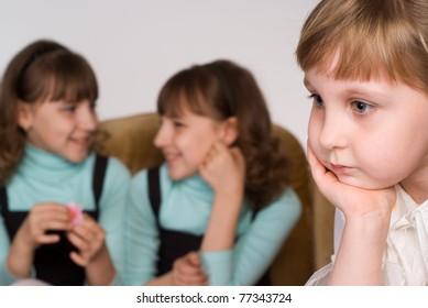 sad girl with her cousins on sofa