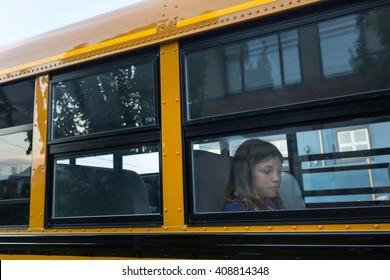 Sad girl on the school bus