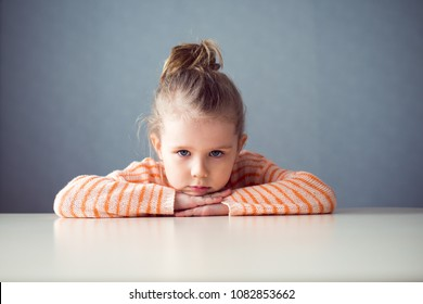 sad girl preschooler at the table