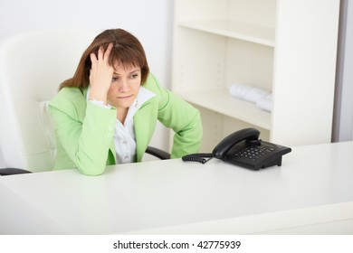The sad girl the secretary waits for phone call