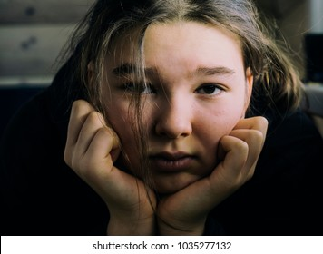 Sad girl teenager close-up portrait
