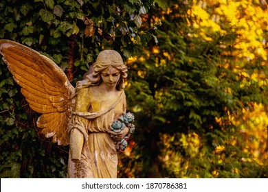 Sad guardian angel. Fragment of an antique statue. Free copy space for design or text.