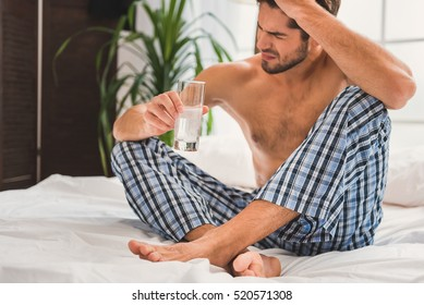 Sad guy suffering from hangover in morning