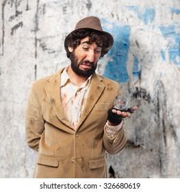 sad homeless man with dice
