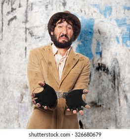 sad homeless man with handcuffs