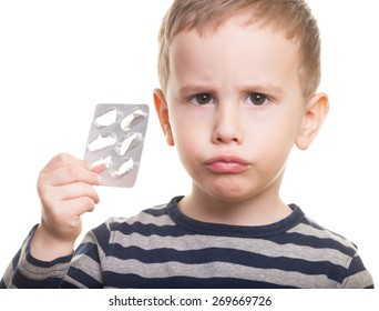 Sad kid with empty blister on isolated white