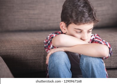 Sad kid lost in his thoughts