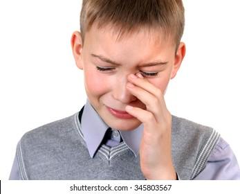 Sad Kid Weeps on the White Background closeup