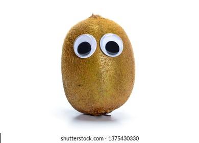 Sad kiwi fruit with googly toy eyes, whole kiwi fruit isolated on white background.