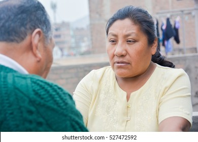 Sad latin woman with her father
