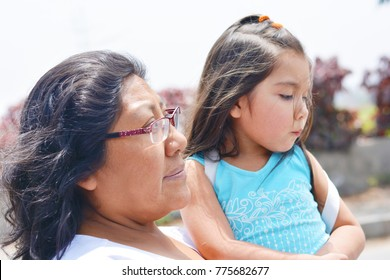 Sad latin woman with her little daughter.