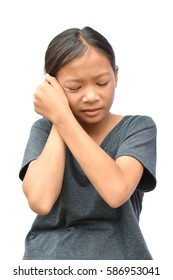 Sad little Asian girl have a earache on white background