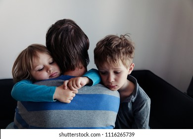 sad little boy and girl hugging father, family in sorrow
