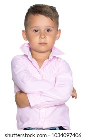 A sad little boy in the studio on a white background. The concept of child development in the family, emotions. Isolated.