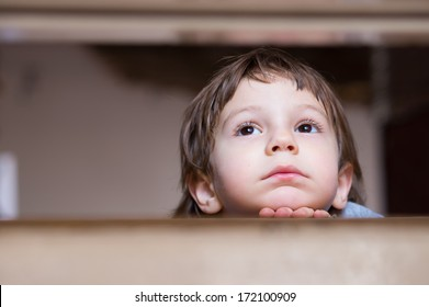 sad little boy thinking looking up