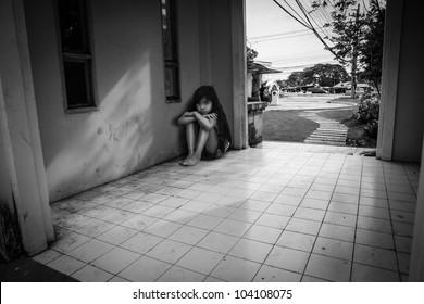 Sad little girl in black & white color
