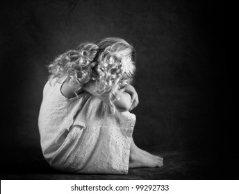 Sad little girl in black and white