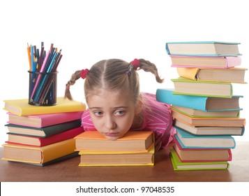 sad  little girl and books