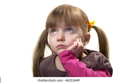 Sad little girl looking up isolated over white background