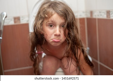 Sad little girl on the toilet. Medical problems, digestive problems (constipation, diarrhea).