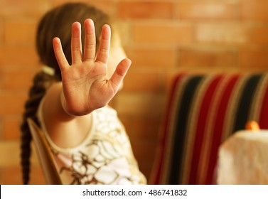 Sad Little Girl showing Stop Hand signaling to stop against Violence and Pain. Closeup portrait